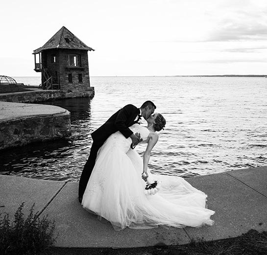Bride & Groom kissing on water
