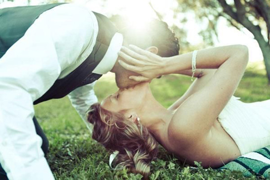 Bride & Groom Kiss in Grass