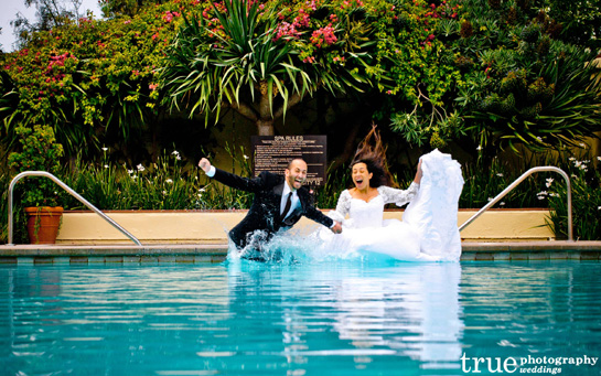 Bride & Groom jump in pool