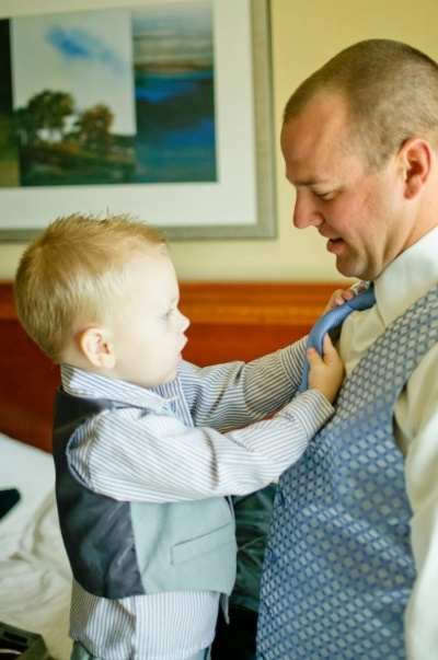 ringbearer helping groom get ready
