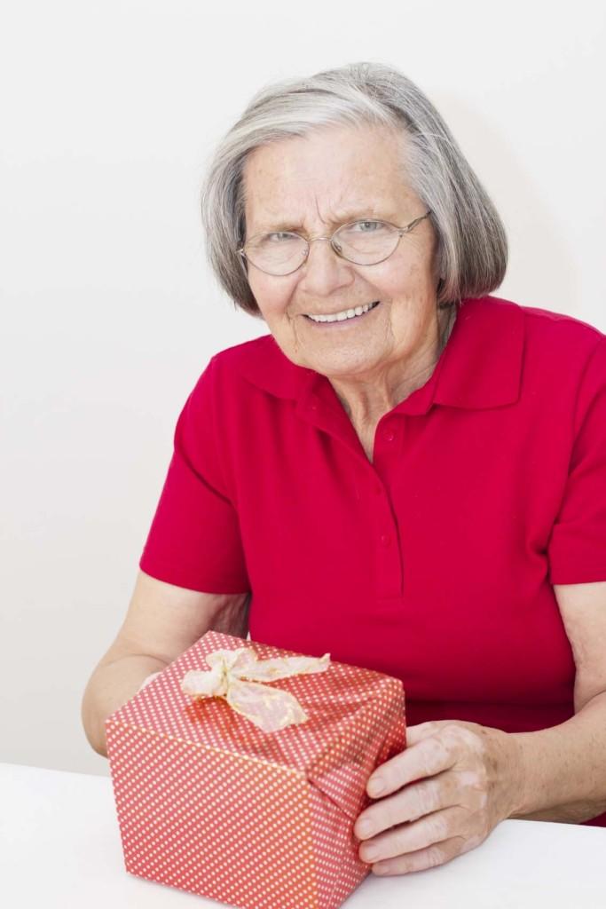Senir woman with gift