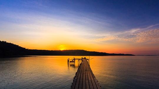 wood bridge on sunset