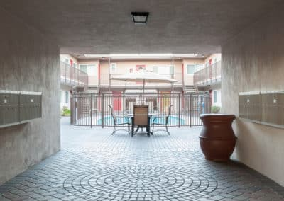Hallway entering pool area with decor