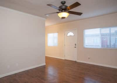 Empty room with dual pane windows and ceiling fan