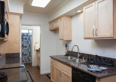 Kitchen with maple cabinets and black counters