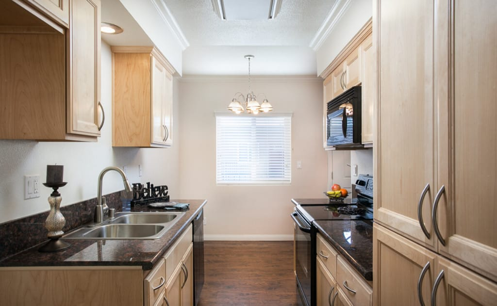 Kitchen with granite counters and custom maple cabinets built in the USA