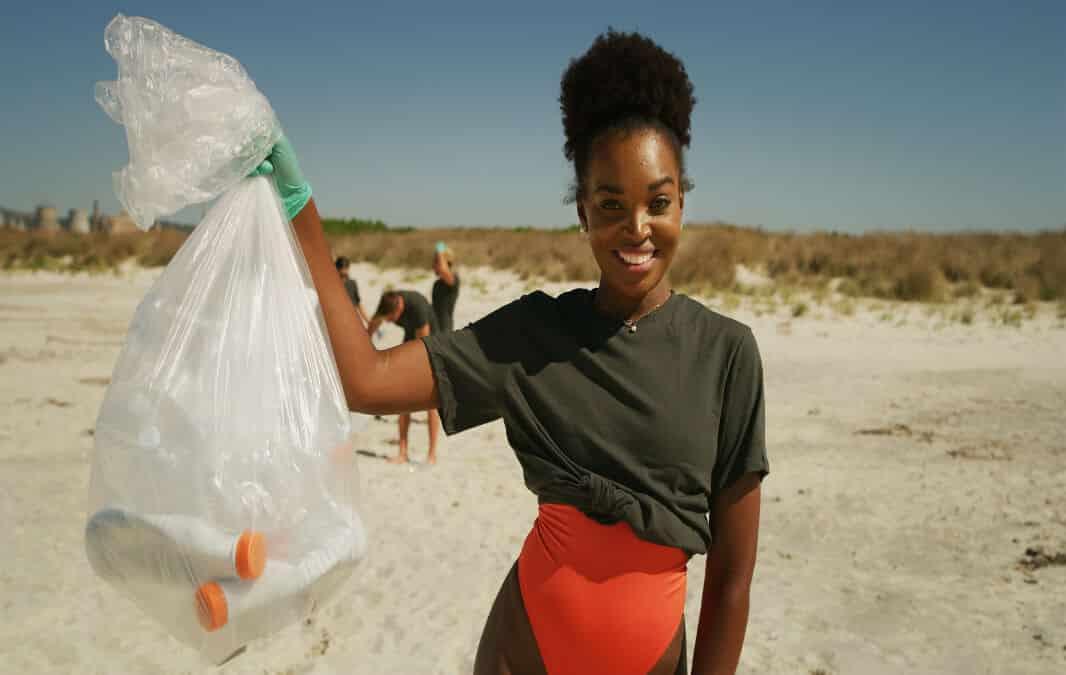 Volunteer having fun cleaning the beach
