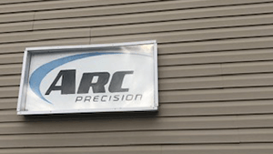 Arc Precision Building Sign