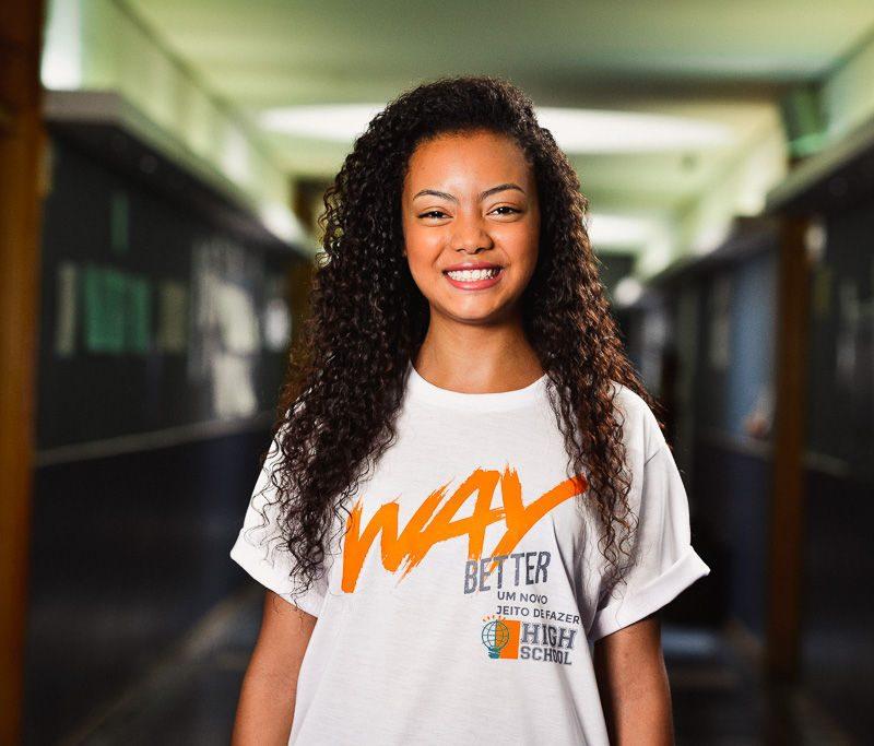 Smiling girl in school hallway