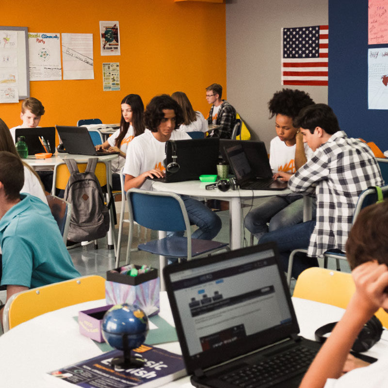 Classroom full of students learning on laptops