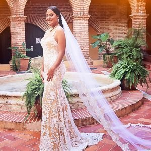 Fisgcut Wedding gown, unique lace gold bridal dress. bride in the court yard