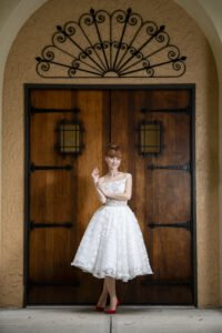 Bride wearing a short wedding dress, off the shoulder lace knee lenght,