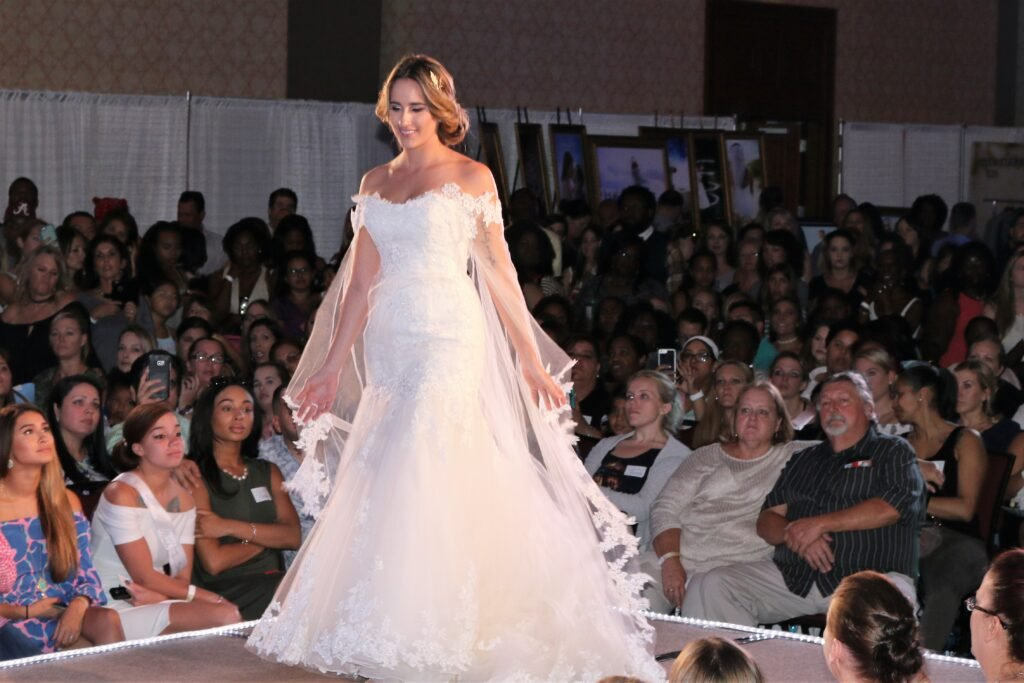 Runway fashion Show, bride long beautiful wedding dress