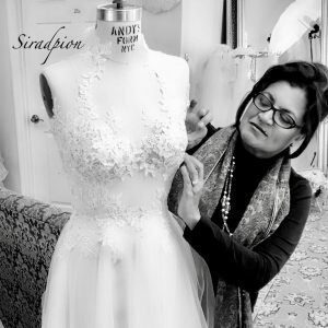 Sira D' Pion working in a dress