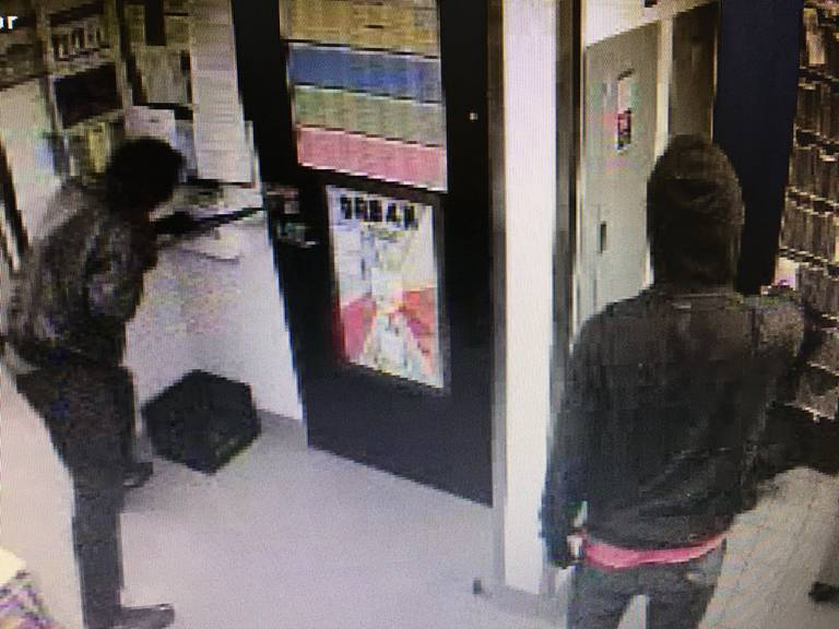 surveillance still of two men robbing a Waffle House in Macon