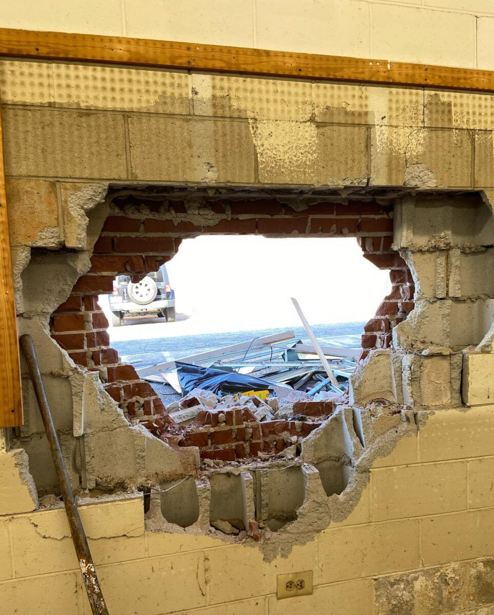 Hole in wall of Forest Park Army Navy store