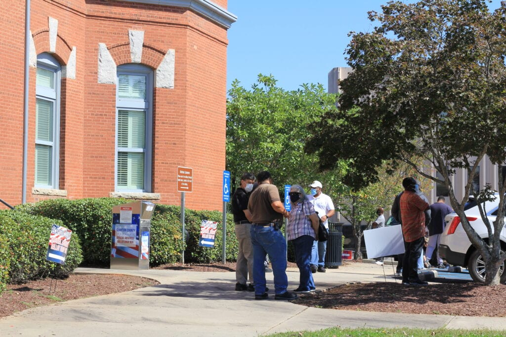 Voters in line next to a ballot box at the Clayton County Courthouse, Jonesboro, GA, Oct. 23, 2020