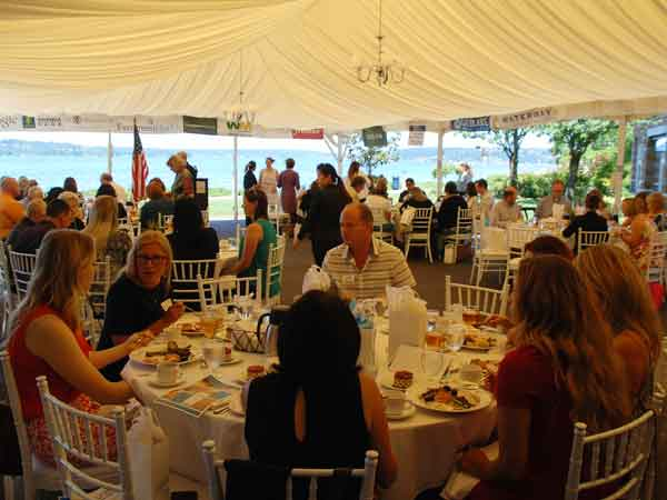 woodmark luncheon event showing members seated inside a marquee