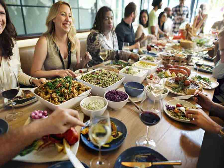 copyright (chocolatemoons LLC) image of people eating lunch at a buffet table