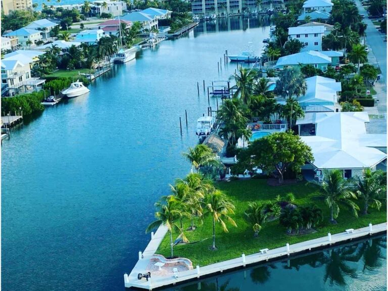 overhead view of luxury vacation rentals in the florida keys on a canal with the atlantic ocean behind