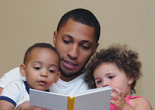 young father reading to his children