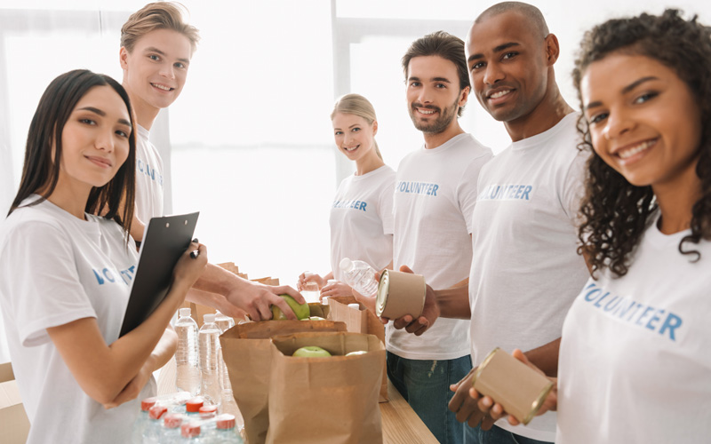 colleagues volunteering at a food drive