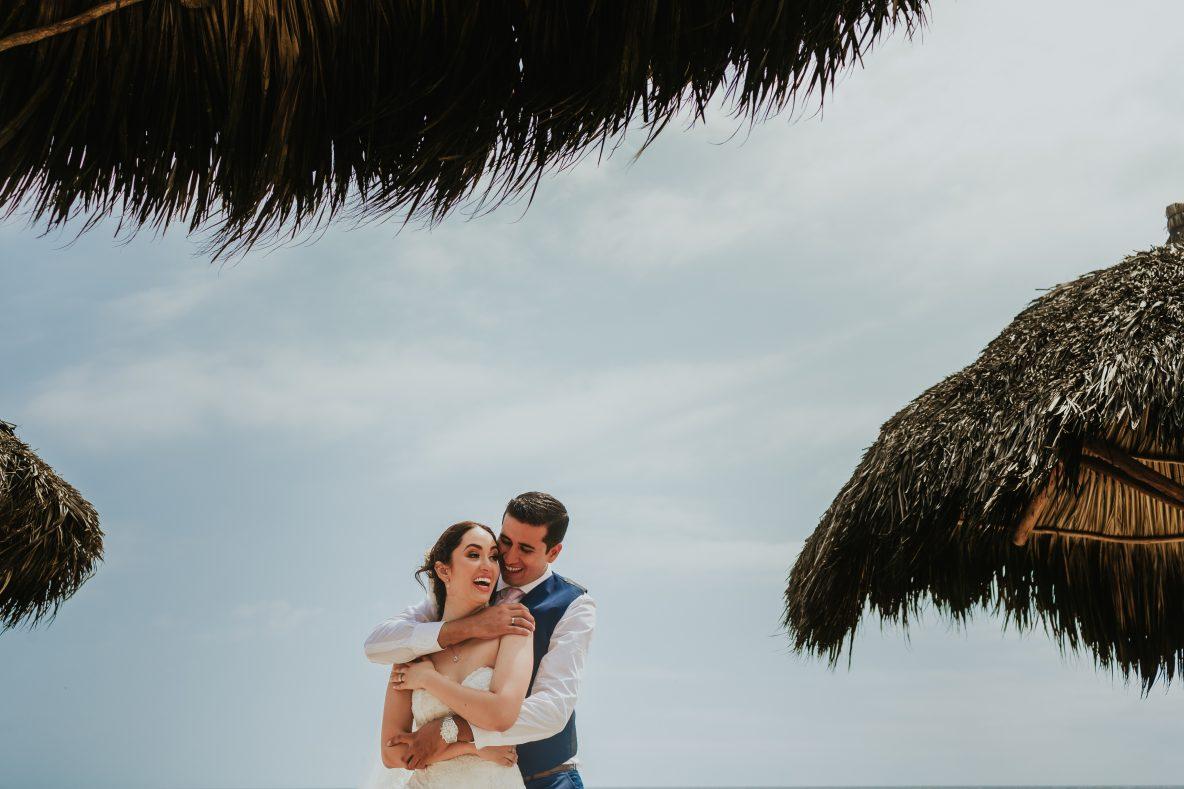 wedding-paertovallarta-hug-groom-bride-smile-sky-moment