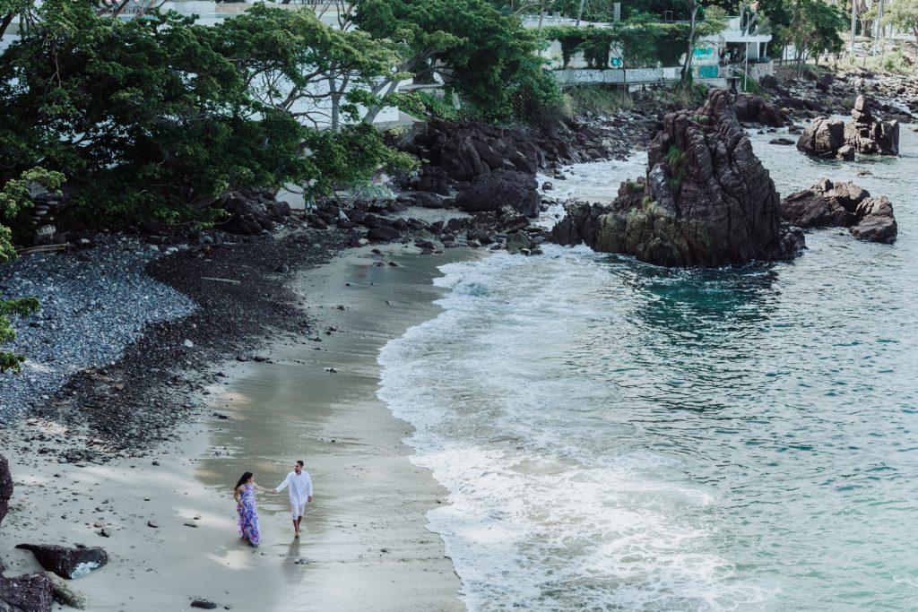 bride groom walk beach ocean rocks couple