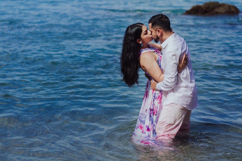kiss couple bride groom love-rocks beach