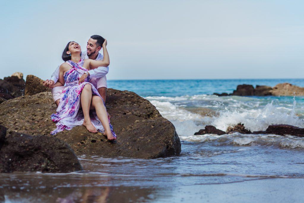 bride groom beach ocean smile hugs love sky