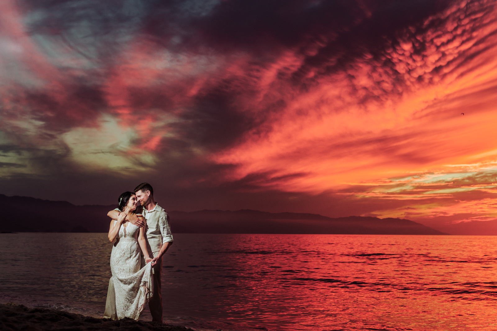 bride groom sunset red sky beach ocean wedding Vallarta mountain
