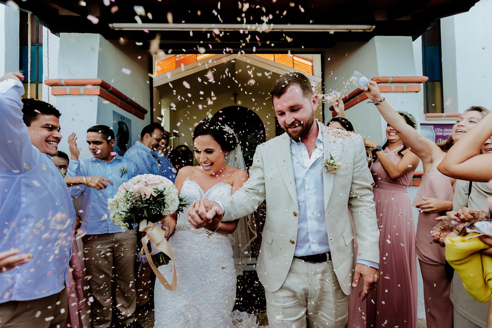 bride-groom-wedding-confetti-church-friends-smile-wedding-vallarta-love