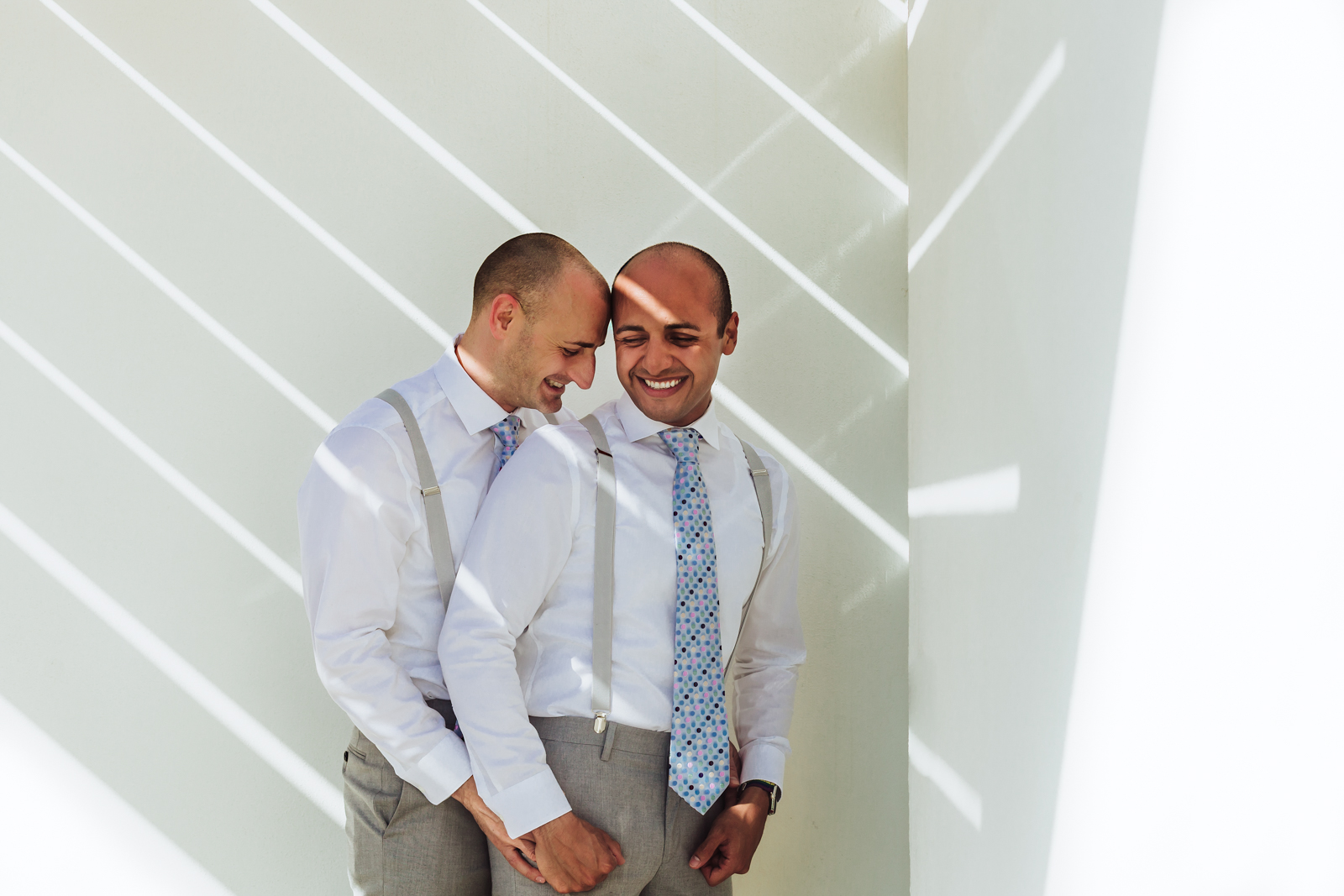 wedding-gay-hug-light-vallarta-hilton-hotel-smile-love