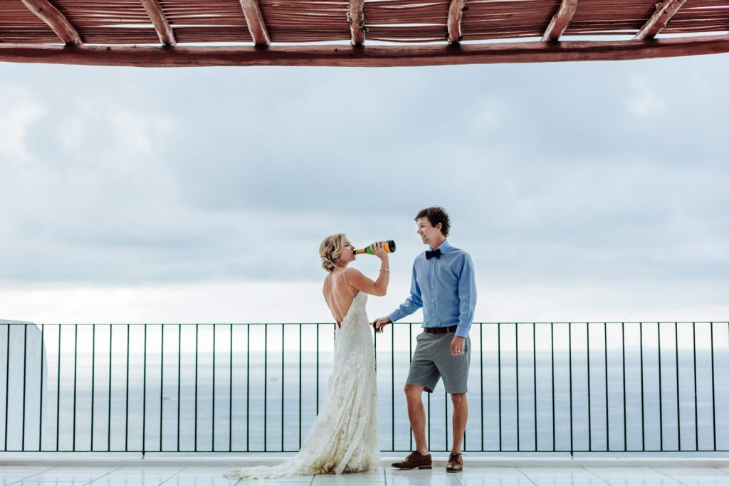 wedding bride groom champagne drink moment ocean sky Vallarta mismaloya