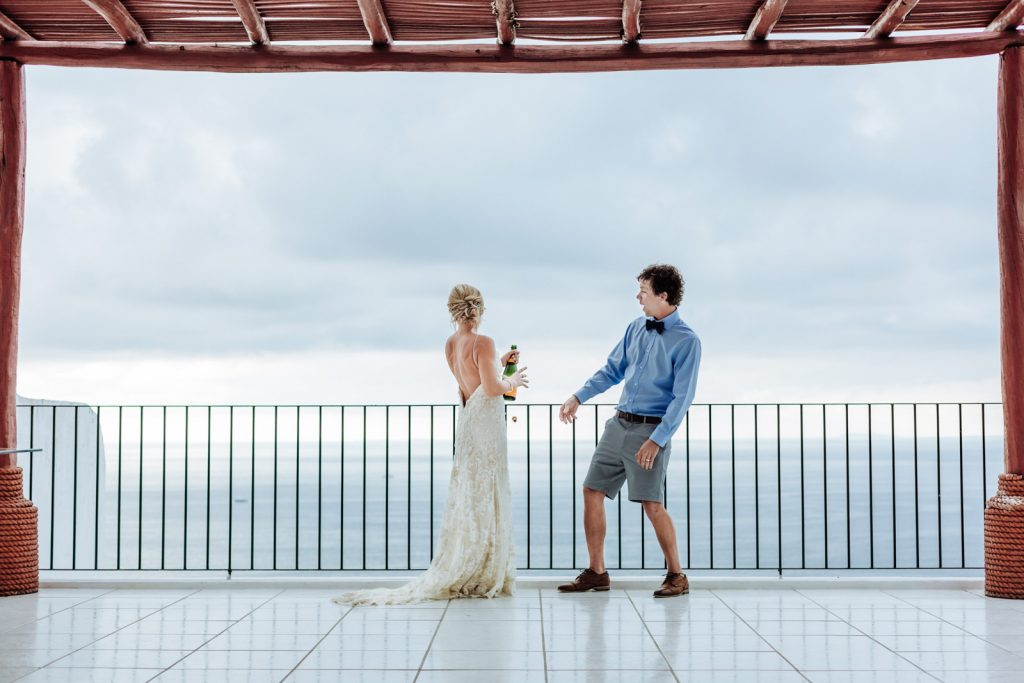 wedding bride groom champagne moment toast ocean sky Puerto Vallarta mismaloya
