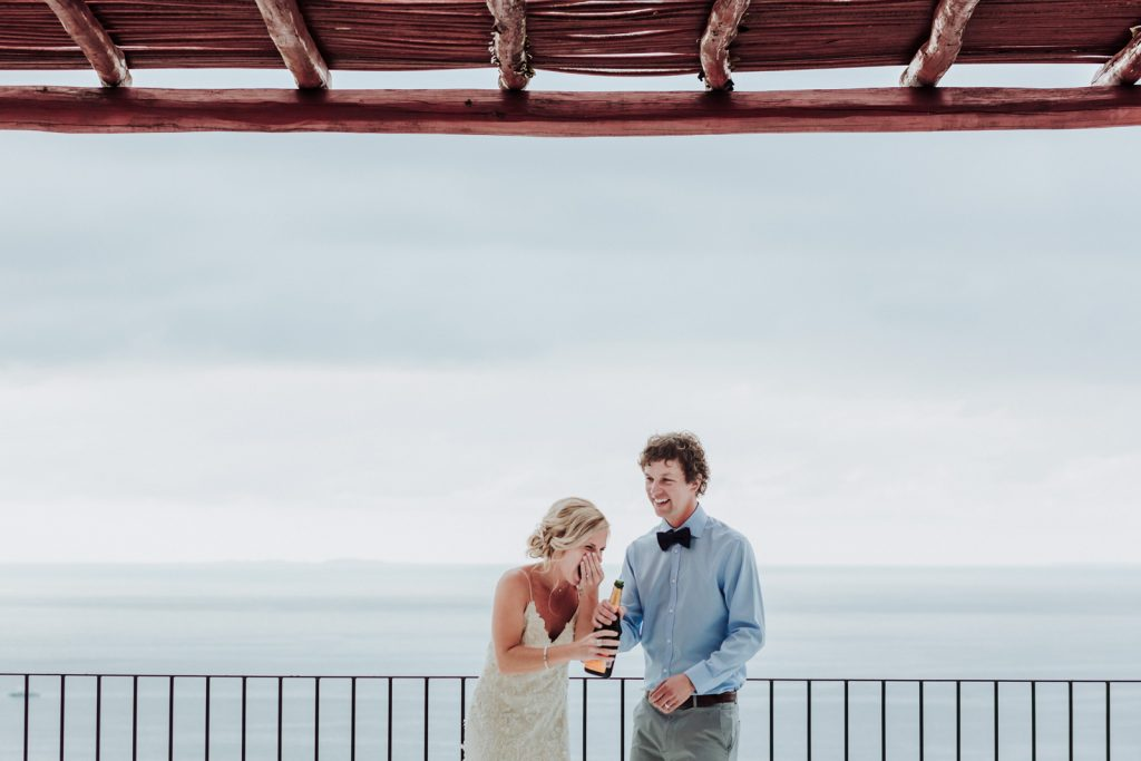 wedding bride groom champagne fun moment drink love ocean Vallarta