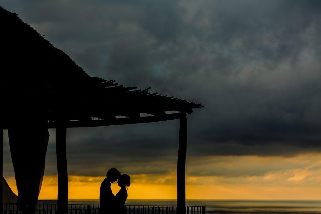 wedding silouette bride groom sunset orange sky clouds ocean roof Vallarta  mismaloya