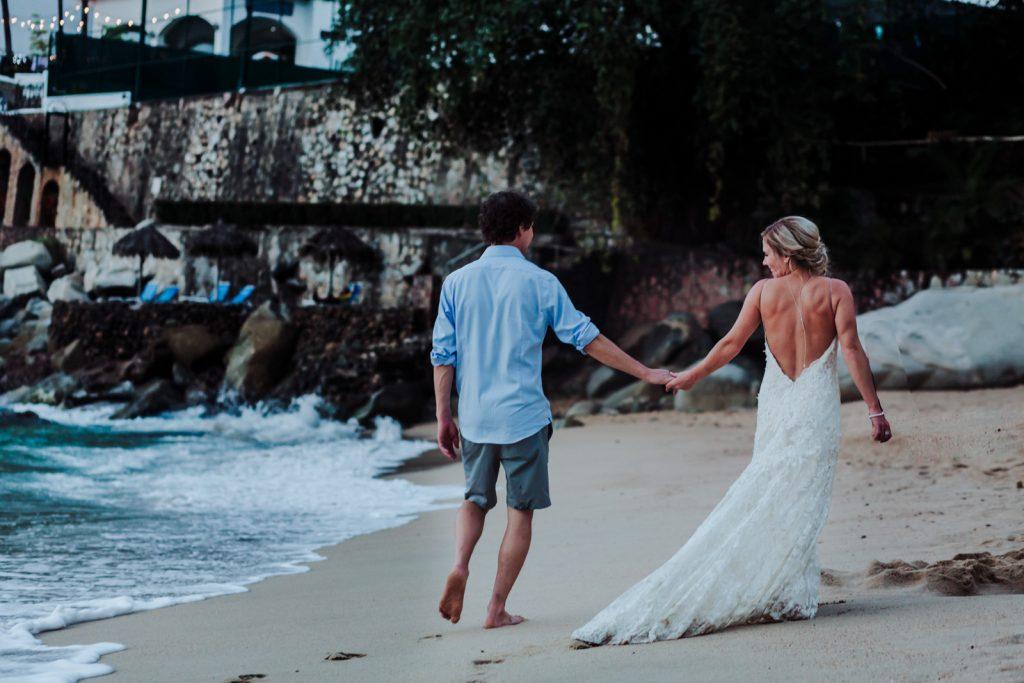 wedding beach Vallarta mismaloya bride groom walking sand rocks look ocean wave