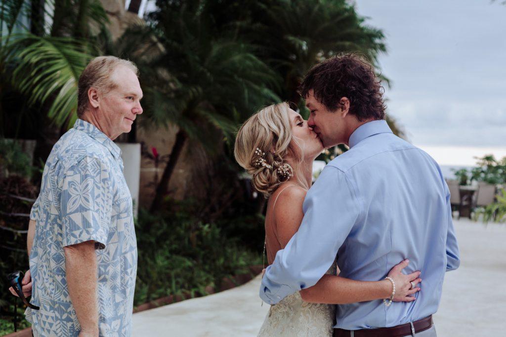 wedding Vallarta mismaloya bride groom kiss dad look