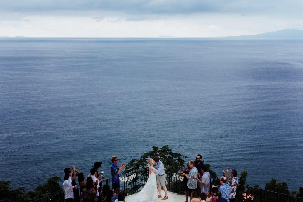 wedding ceremony kiss bride groom guest ocean Vallarta mismaloya tes beach sky