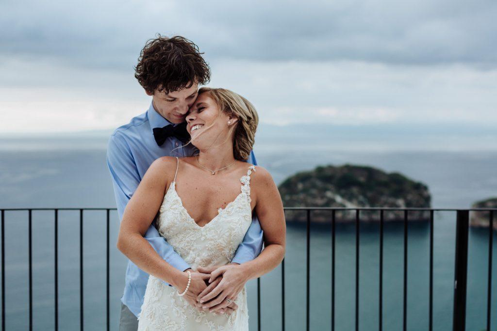 wedding bride groom hug smile los arcos ocean Vallarta mismaloya