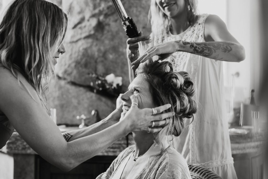 wedding girlfriends gettin ready smile hands on the face bride tattoos