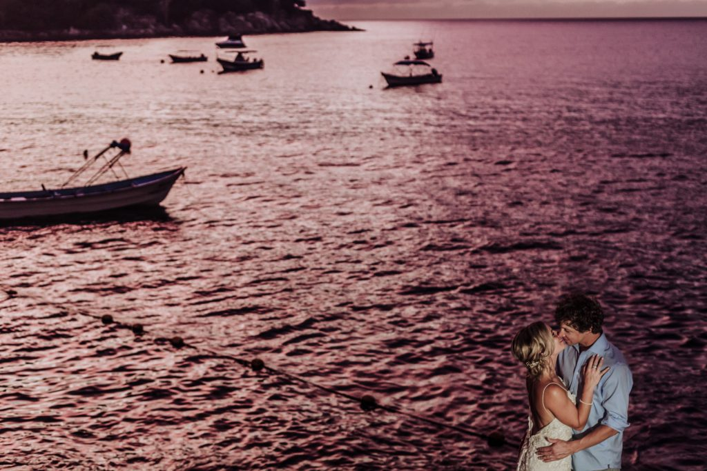 wedding bride groom kiss ocean pink sunset boat love Vallarta mismaloya