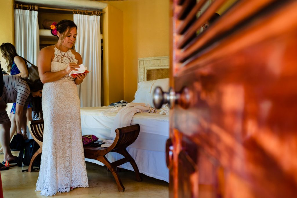 bride riding the vows  before the ceremony in her hotel room almost ready to getting married