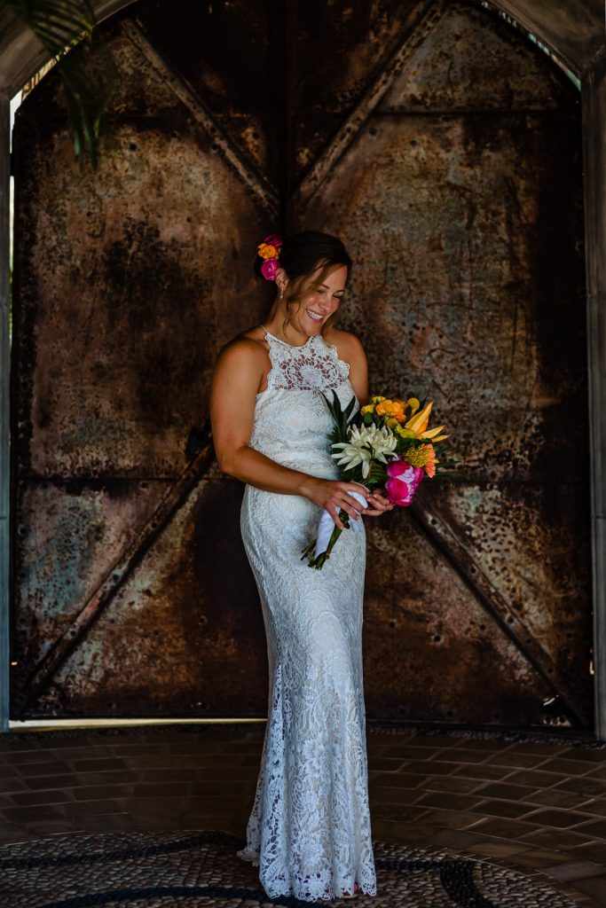bride portraits with flowers by a rusty door just before the ceremony