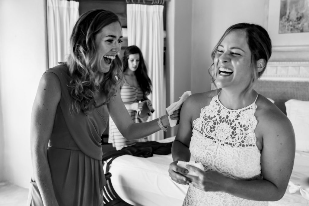 bride and bridesmaid smile before the ceremony