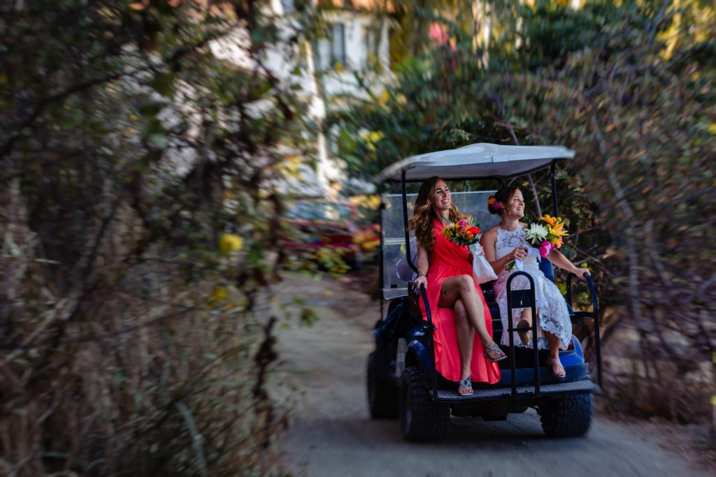 bride and bridesmaid going on golf cart and have fun