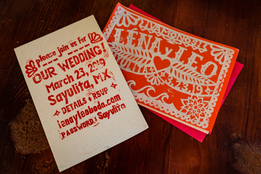 letters and invitation cards with bride and groom names