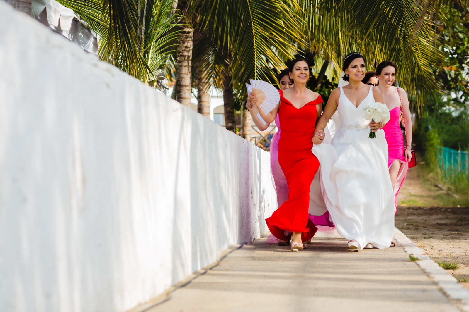 bride walk to the ceremony with family mum moment destination wedding