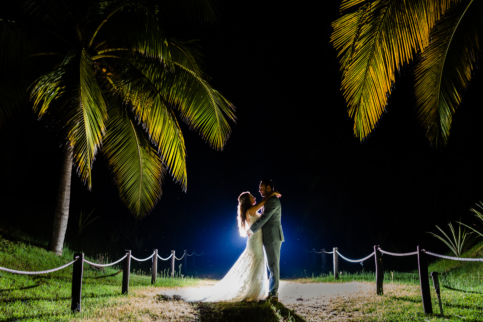 bride and groom with a back light on a garden